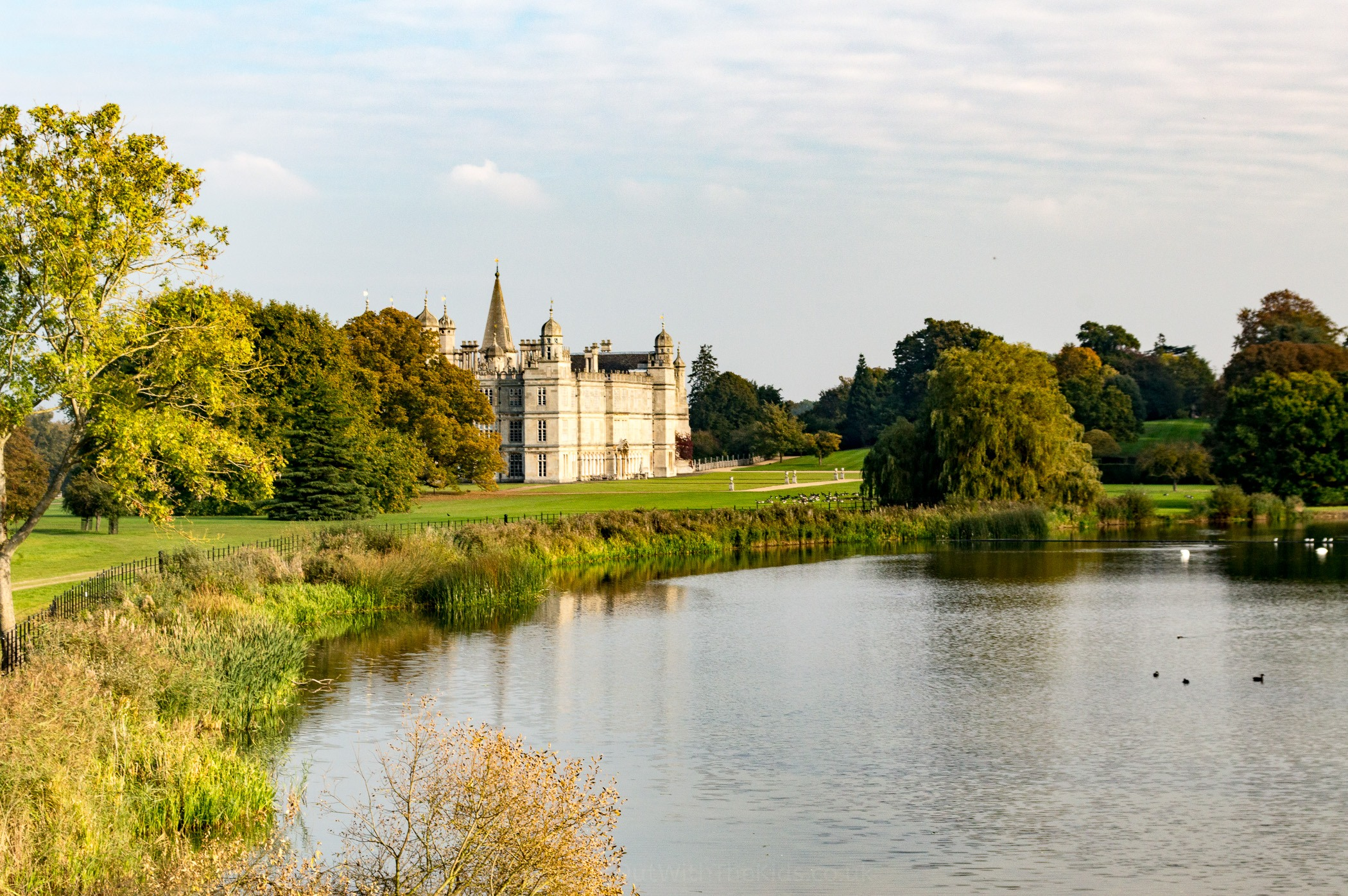 Burghley House next to the lake