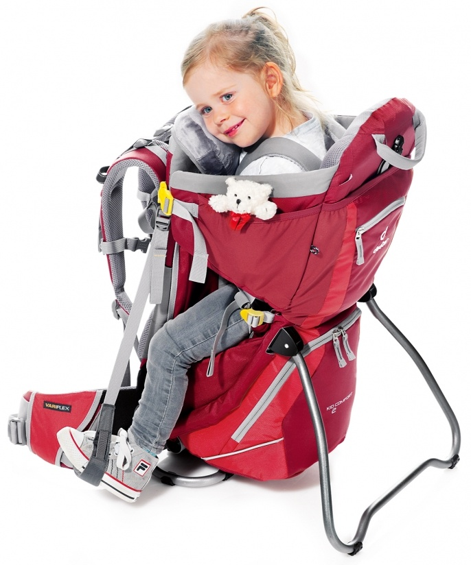 Putting child into the child carrier