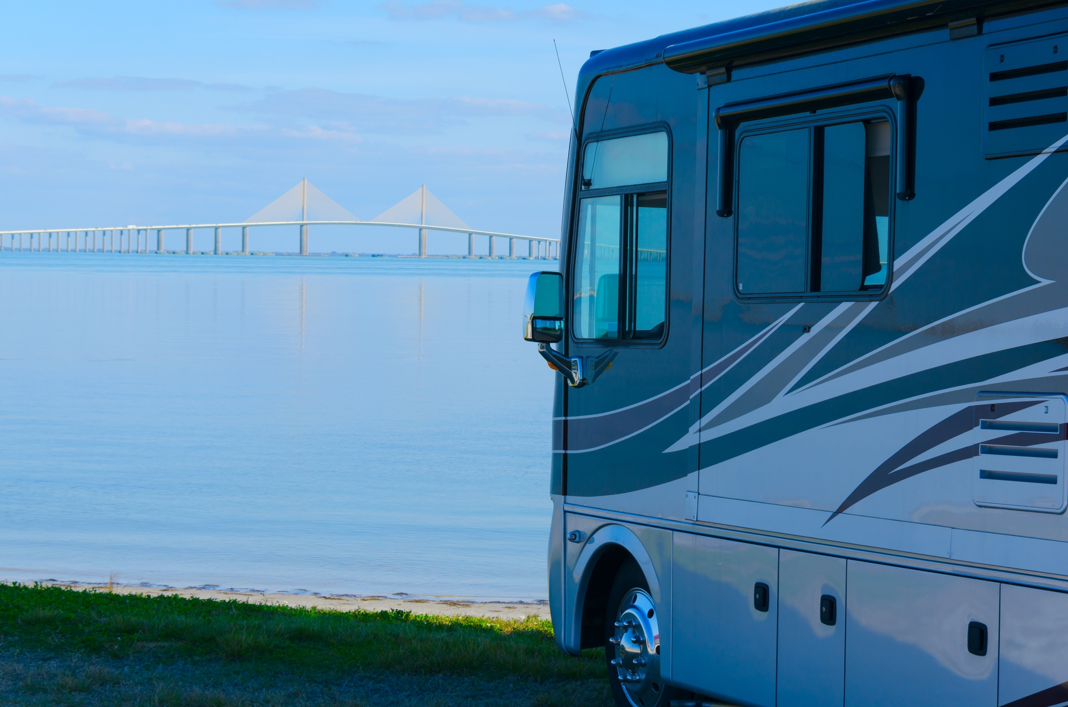 RV at beach with Tampa Bay Skyway Bridge